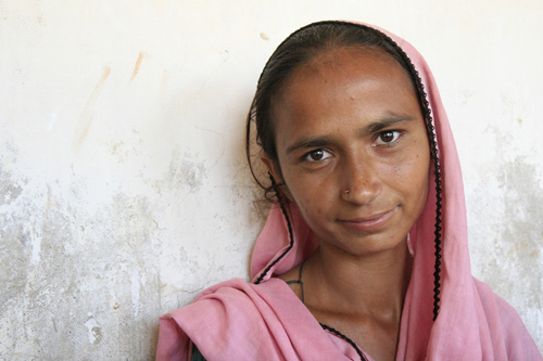 """I want to rebuild our home... and restart our livelihood,"" says Raiza, pictured, whose farm was destroyed in Pakistan's recent floods. Photo: Jane Beesley / Oxfam"