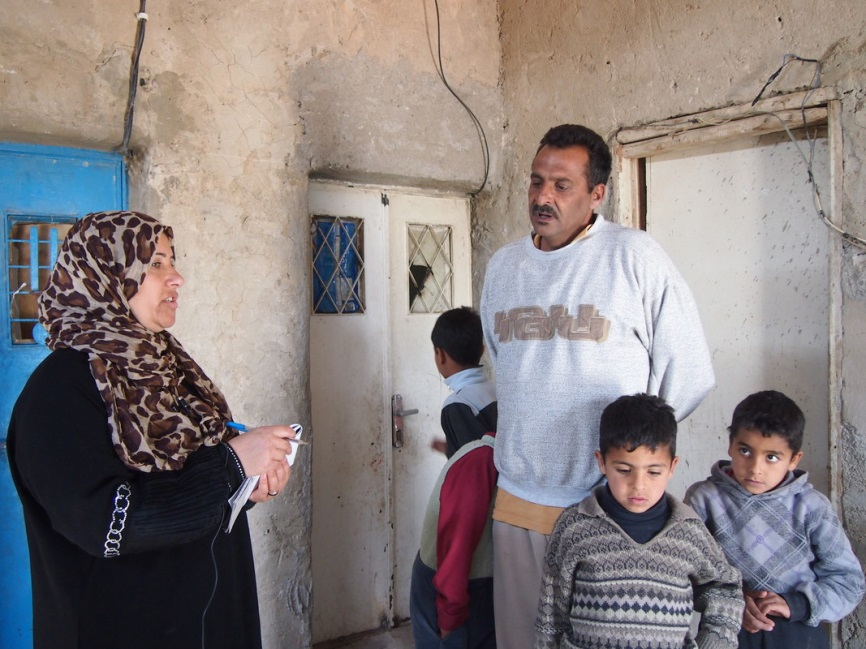 Najah, left, a refugee from Damascus, is one of the citizen reporters participating in the project. She collects stories each week from other refugee families in her neighborhood in Jordan. Photo: Caroline Gluck/Oxfam