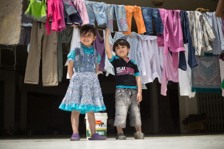Judi and Mohammed in their family's temporary home: an abandoned shopping center in Tripoli, Lebanon. Photo: Sam Tarling/Oxfam