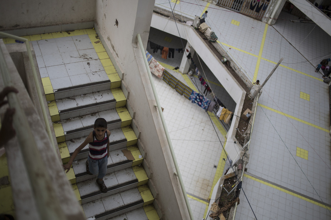 About 100 refugee families from Syria are now living in this abandoned shopping center in Lebanon. Photo: Sam Tarling/Oxfam