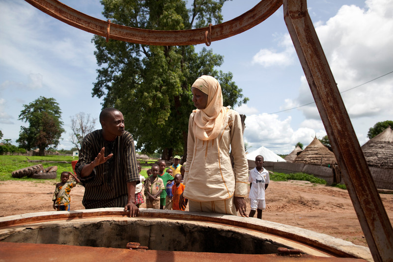 Staff from Oxfam's partner FODDE in Kolda, Senegal, looking at a well in need of rehabilitation. Photo by Holly Pickett/Oxfam America