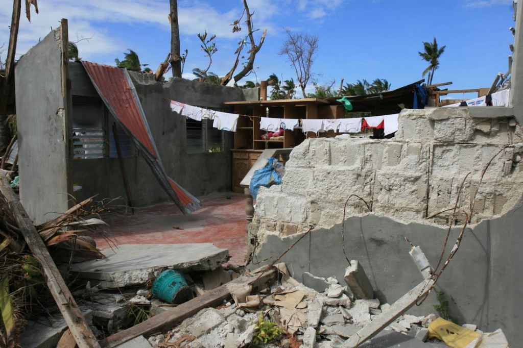 Falling trees and heavy winds almost completely destroyed Emelia Tiongzon's home on Bantayan Island. Photo by Jane Beesely/Oxfam