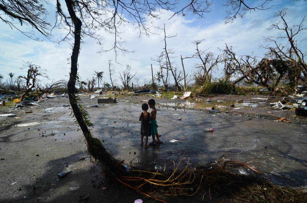Two young boys stand in Tacloban City, Leyte, Philippines, looking at the devastation caused by Typhoon Haiyan. Photo: Dondi Tawatao/Getty Images