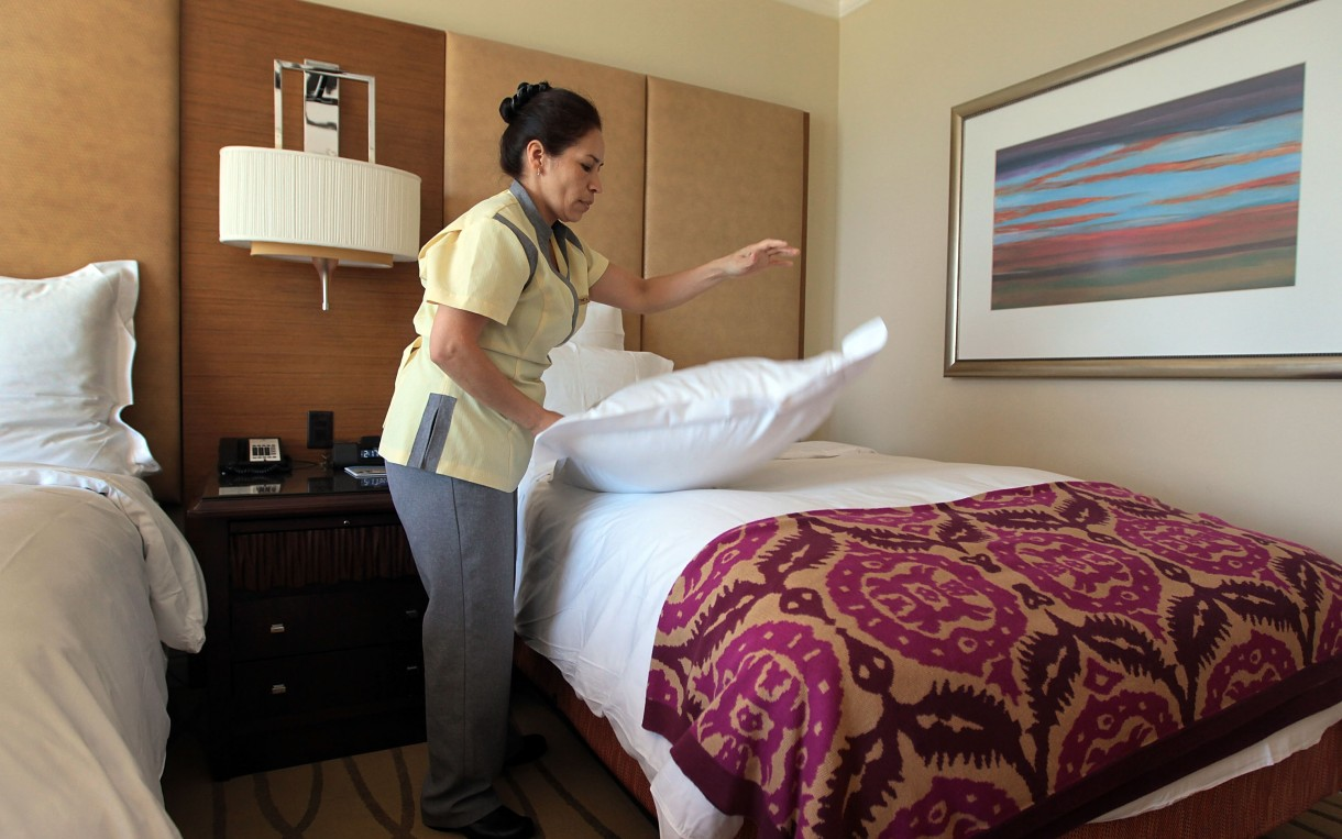 Housekeeper Maria Antonieta prepares a room at the Ritz-Carlton in Key Biscayne, Fla. Nearly a million people work as maids and housekeepers in the US, with a median hourly wage of under $10, according to the Bureau of Labor Statistics. Photo: Joe Raedle / Getty Images