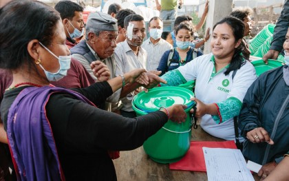 Oxfam distributes hygiene kits in Sankhu. The kits contain a bucket for clean water, a bar of soap, oral rehydration salts, and towels, helping people to meet their basic sanitation needs. Oxfam has also provided the community with emergency latrines to help prevent the outbreak of infectious diseases.  Photo: Aubrey Wade / Oxfam