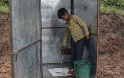 Latrine installed by Oxfam near Kathmandu, Nepal, after the April 2015 earthquake. Two thirds of the houses in this village were destroyed. Oxfam delivered water storage tanks, toilets, and hygiene kits to help people avoid water-borne diseases. In total, Oxfam estimates it built nearly 8,000 latrines in Nepal over the last six months. Photo: Sam Tarling/Oxfam
