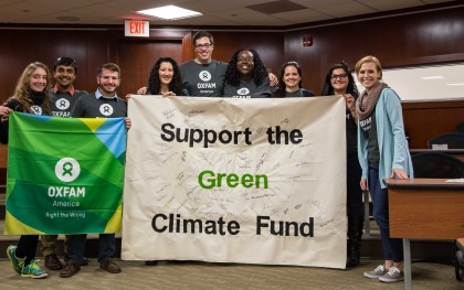 Oxfam Action Corps members with the banner they used to collect signatures at a film screening and panel discussion about climate change in October, 2015, in Washington, DC. Photo by Tapan Bhargava