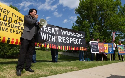 Roughly 40 workers, advocates, and supporters rallied outside the Tyson headquarters in Springdale, AR on May 11, 2016. After several people spoke about the need for Tyson to treat its workers better (including this Catholic priest), the protestors marched to the front entrance to deliver over 150,000 petition signatures. Photo: Coco McCabe / Oxfam America
