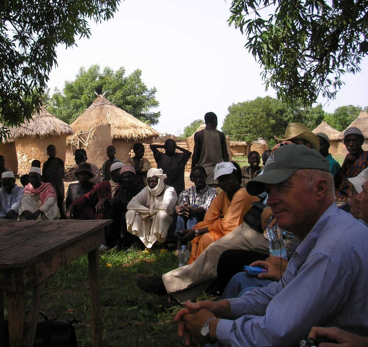 US farmer Charlie Melander visits with farmers in Mali. Photo by Jim French/Oxfam America