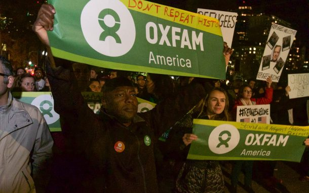 Kofi Bosque Hamilton joins others from Oxfam America at a rally outside the Boston State House in support of Syrian refugees. Photo: Coco McCabe / Oxfam America