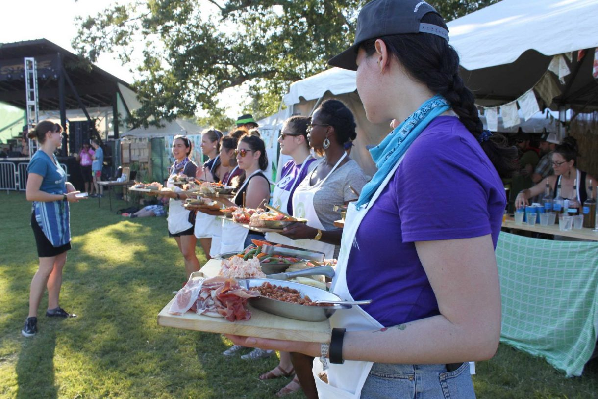 Emily Torgrimson (left) with volunteer servers before the Bonnaroots dinner. Photo by Bob Ferguson/Oxfam America