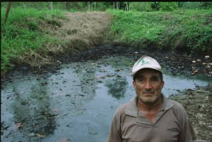 One of hundreds of open oil pits left by Texaco in the Amazon.  Photo by Coco Laso/Oxfam America.