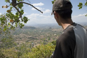 A resident of Cabaňas, El Salvador looks out over a valley where Pacific Rim hopes to begin mining for gold and silver.  Picture by Jeff Deutsch/Oxfam America, 2007.