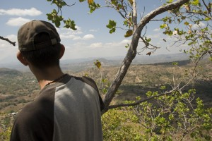 A Resident of San Isidro (Cabañas, El Salvador) looks out over a valley where Pacific Rim hopes to mine gold and silver. Photo by Jeff Deutsch/Oxfam America.