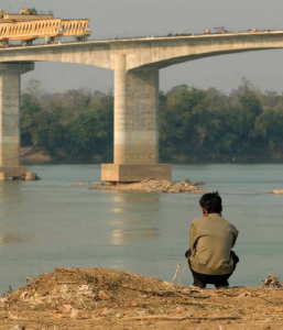 This bridge spanning the Sekong River, shown in 2007, is slated to be part of a highway connecting Laos and Cambodia. The bridge and highway will help Cambodians engage in trade with their neighbor. Brett Eloff / Oxfam America