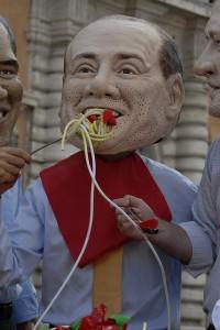 Berlusconi eating spaghetti. Ilaria DiBagio/Oxfam-UCODEP
