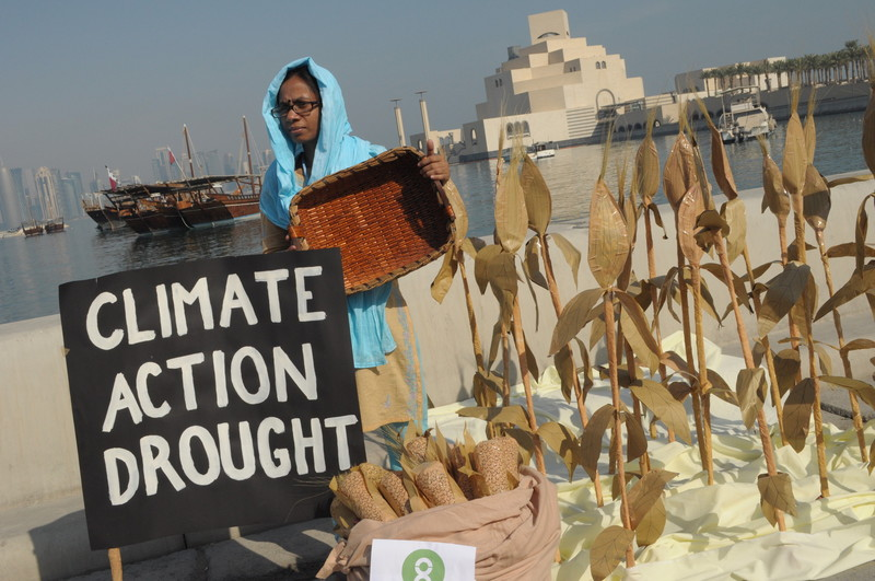 Qumrunnessa Nazly from Bangladesh held an empty basket amidst a field of dead corn set in front of the glittering Doha skyline during COP18 last year, to demonstrate the grave impact of a changing climate on food supply and food prices, and the crucial importance of the UN climate change negotiations in providing a solution. Photo: Richard Casson / Oxfam