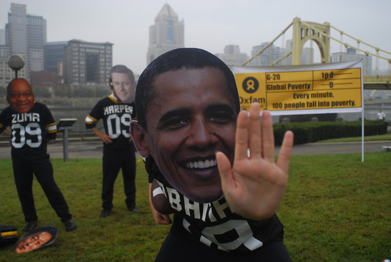 """How will Obama tackle issues of poverty and inequality in Africa? Oxfam campaigners and volunteers wearing """"Big Heads"""" representing G20 leaders in 2009. Photo: Chris Rolinson / Oxfam America"""