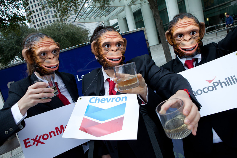 "Last year activists outside the offices of Chevron in Houston, Texas called for oil companies to accept strong rules to implement the transparency provisions in the Dodd-Frank Wall Street Reform Bill. Oxfam members portrayed oil companies as monkeys in the ""see no evil, speak no evil"" proverb, as a way to expose efforts by the oil industry to encourage the Securities and Exchange Commission to enact weak rules that will allow them to continue to make secret payments to governments. Photo: Scott Dalton / Oxfam America"