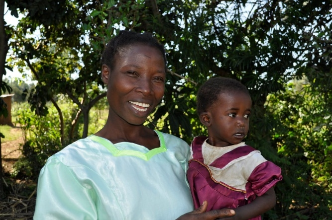 After participating in a Feed the Future loan program, Robai Nyongesa drastically increased her maize yield and is selling the surplus to improve the house she lives in with her three children. Photo:  http://bit.ly/1dk0ULI