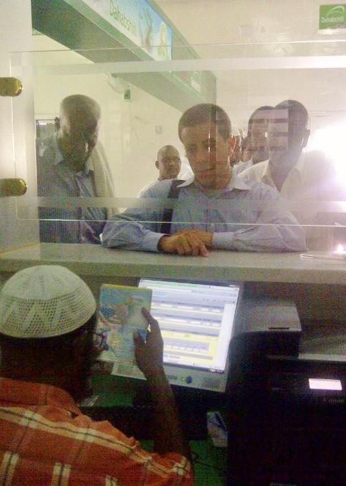 A remittance clerk examines Scott Paul's passport during his trip to Somaliland last year. Photo: Scott Paul