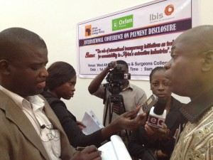 Hon. James Avedzi, Member of the Ghanaian Parliament and Chairman of the Select Committee on Finance (far right), speaks to the media at the International Conference on Payment Disclosures in the Extractive Industries in Accra on August 1st.