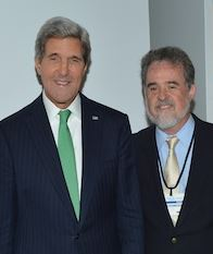 US Secretary of State John Kerry is congratulated by Oxfam America president Ray Offenheiser for signing the ATT in New York on September 25th. Photo: US Department of State