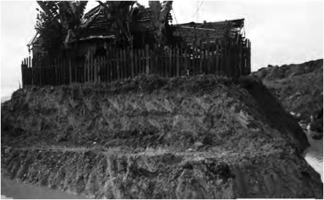 The home of Manolita y Loloy Galvez, who refused to sell their property to a mining company. The company then built the mine around their house. Photo courtesy of DIOPIM Committee on Mining Issues (DCMI).
