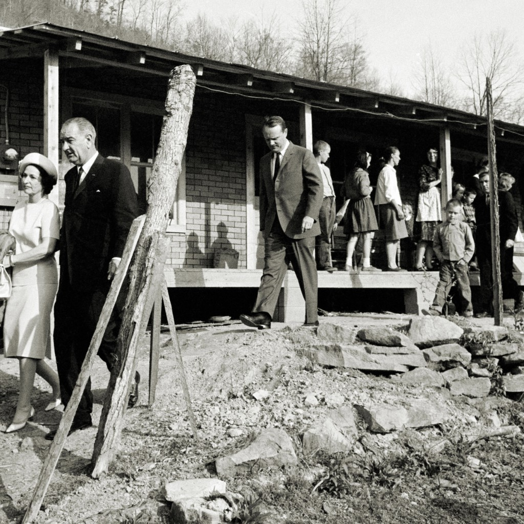 President Lyndon B. Johnson and his wife, Lady Bird, leave the home of Tom Fletcher, a father of eight who had been out of work for nearly two years. The President launched his War on Poverty from the Fletcher porch in Inez, Kentucky on April 24, 1964. Photo: http://bit.ly/1gC1Ajk