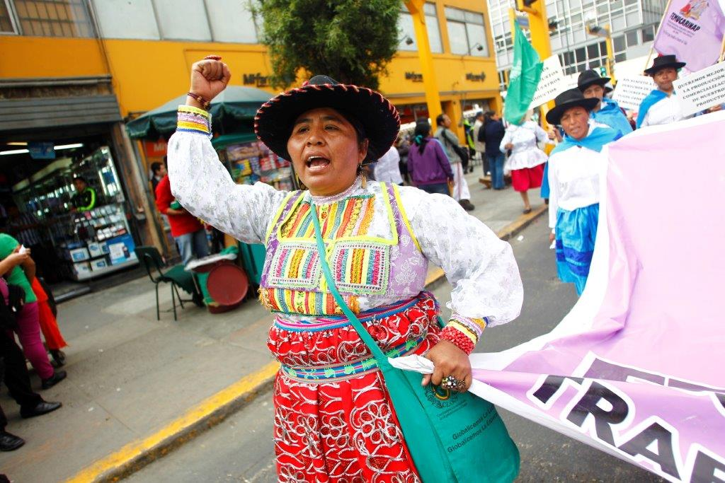 Lourdes Huanca, president of FEMUCARINAP, an Oxfam ally organization, led a march of indigenous women through the streets of Lima, Peru, on World Food Day, October 16, 2013. Huanca's group called for increased recognition of the role of women farmers as well as greater investment in rural food security throughout Peru. Photo: Percy Ramírez/Oxfam America