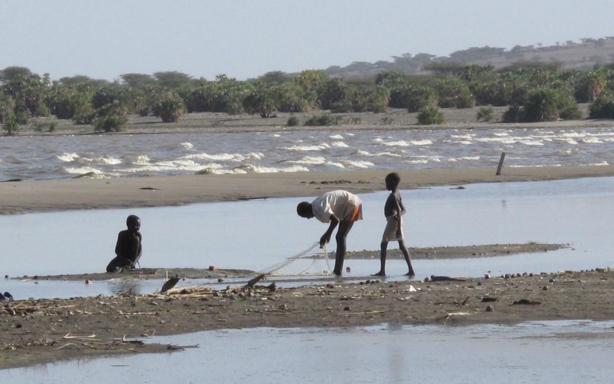 Children play in the water on the shore of Lake Turkana in Nasechabuin village of Northern Turkana. Photo: Caroline Gluck/Oxfam
