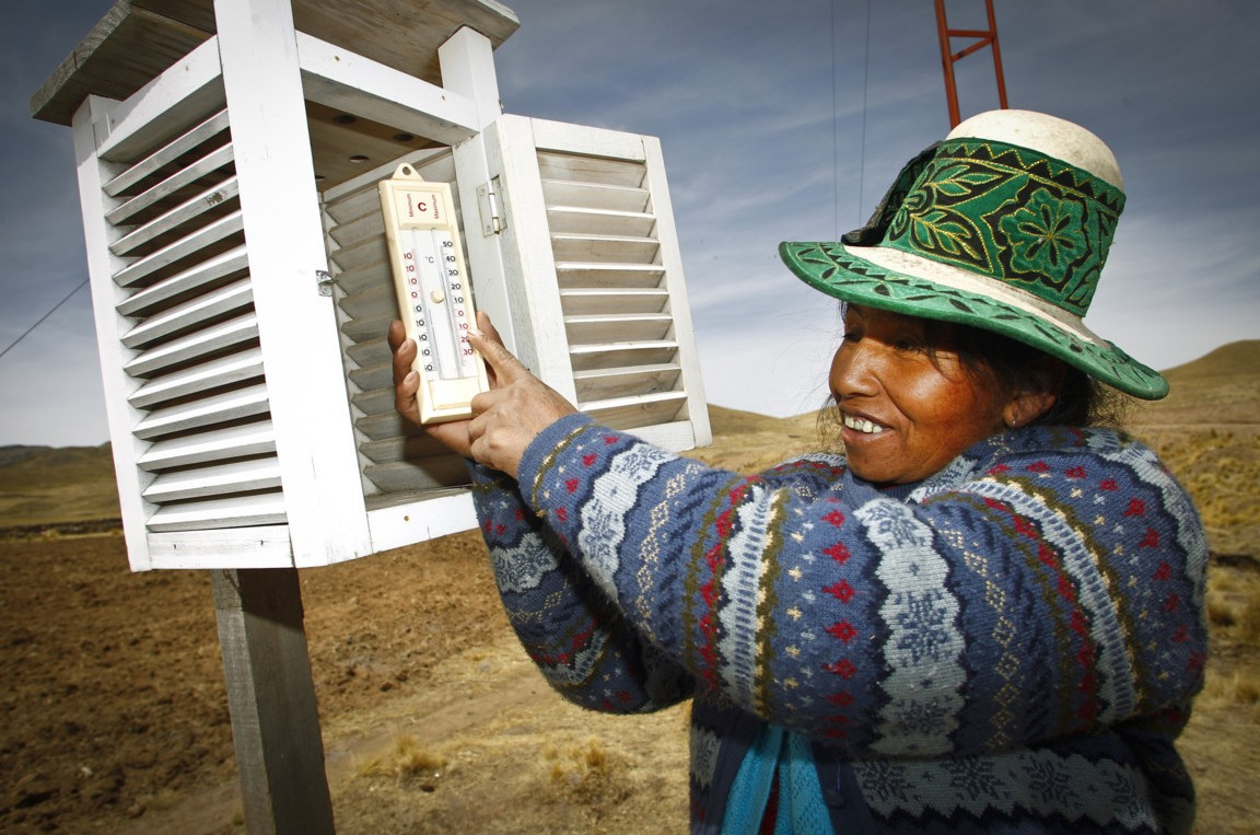 Ricardina Sune Llasa holds a thermometer used at a weather station in the Peruvian highlands. From 2009-2012, Oxfam America supported rural indigenous people in the mountainous region of Espinar, Peru to become more resilient in the face of rainfall shortages, extreme cold, and other life-threatening consequences of climate change and to monitor weather data to respond to climate-related emergencies. Groups like these in Peru could utilize additional financial and technical support. Photo: Percy Ramírez / Oxfam America