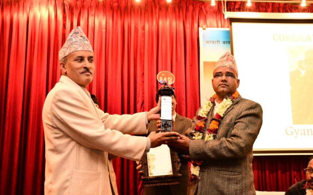 District Education Officer Gyan Mani Nepal (right) used innovative means to ensure that teachers in his district were doing their jobs. Because of his efforts, he received Nepal's first Integrity Idol Award in January. Photo courtesy of Integrity Idol Nepal.