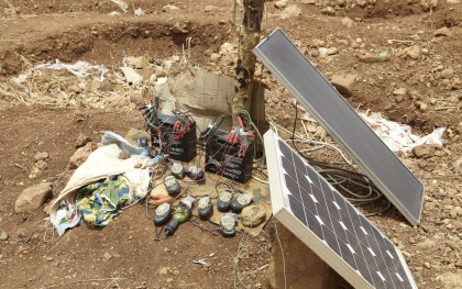 Make-shift solar panels charge up mobile phones in Burkina Faso. (Photo: Andy Hall/Oxfam Great Britain)