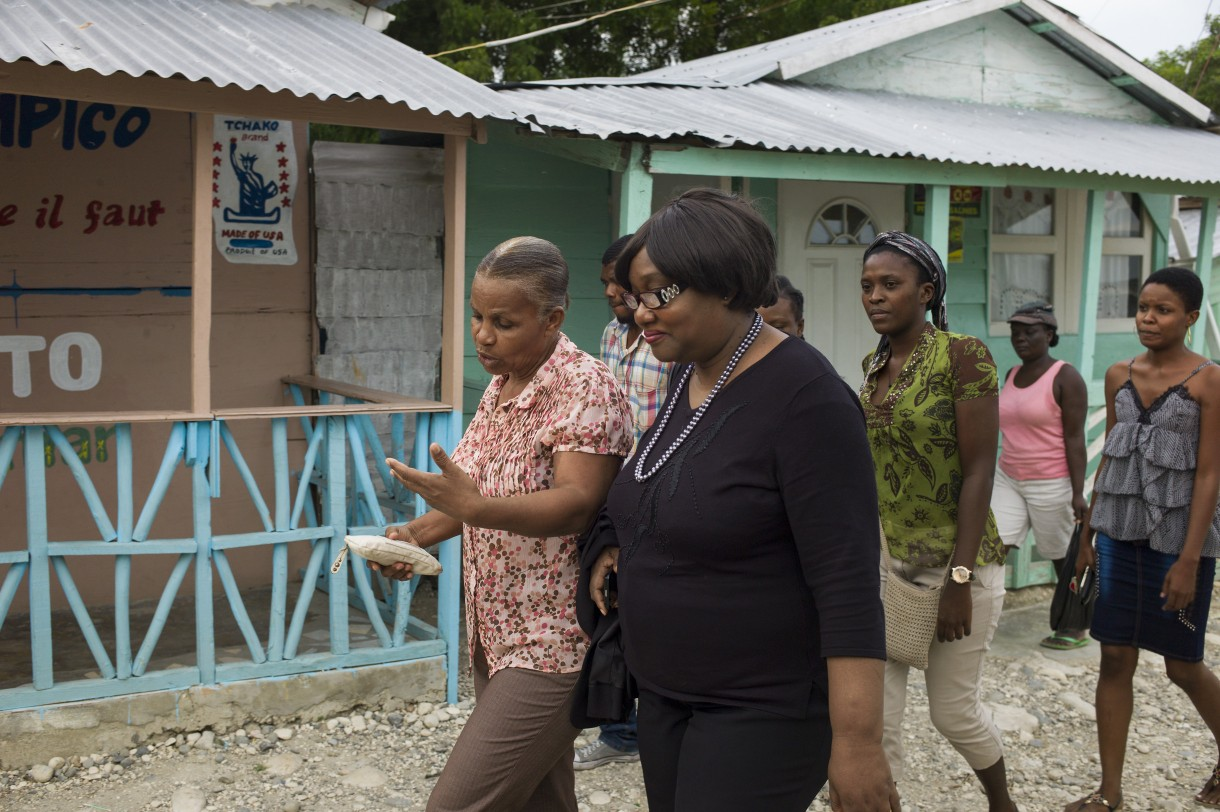 Caradeux community volunteers walk with Marie Alta Jean-Baptiste, director of Haiti's Civil Protection Division during her visit to hear about the community's disaster risk reduction efforts. Photo: Anna Fawcus / Oxfam America
