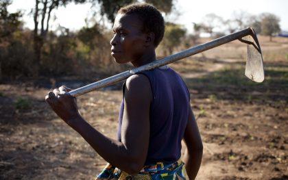 Barbara, a low-income farmer in Chiawa, Zambia on her way to her fields. (Photo: Abbie Trayler-Smith / Oxfam)