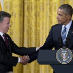 President Obama shakes hands with Colombian president Juan Manuel Santos after the announcement of Paz Colombia (Peace Colombia) at the White House in February. (Photo: Carolyn Kaster / AP)