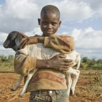 A boy holds a lam in Burkito, Ethiopia. (Photo: Eva-Lotta Jansson/ Oxfam America)
