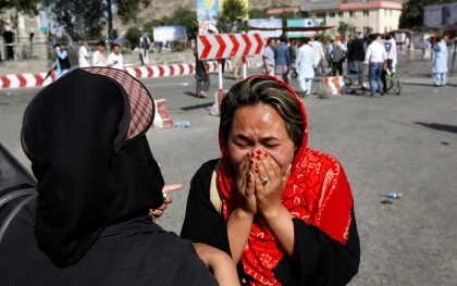 Afghan woman at the site of the suicide attack in Kabul, Afghanistan on July 23, 2016. Photo: Reuters