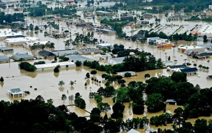 Aerial image of flooded areas in Denhamp Springs, La., Saturday, Aug. 13, 2016. More than 35,000 people in south Louisiana have been rescued from homes, vehicles and even clinging to trees as a slow-moving storm hammers the state with flooding. (Photo: Patrick Dennis/The Advocate via AP)