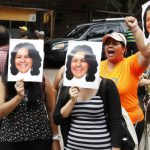 Women demonstrators hold up photos of slain Honduran indigenous leader and environmentalist Berta Caceres outside the coroners office in Tegucigalpa, Honduras. (AP Photo/Fernando Antonio)