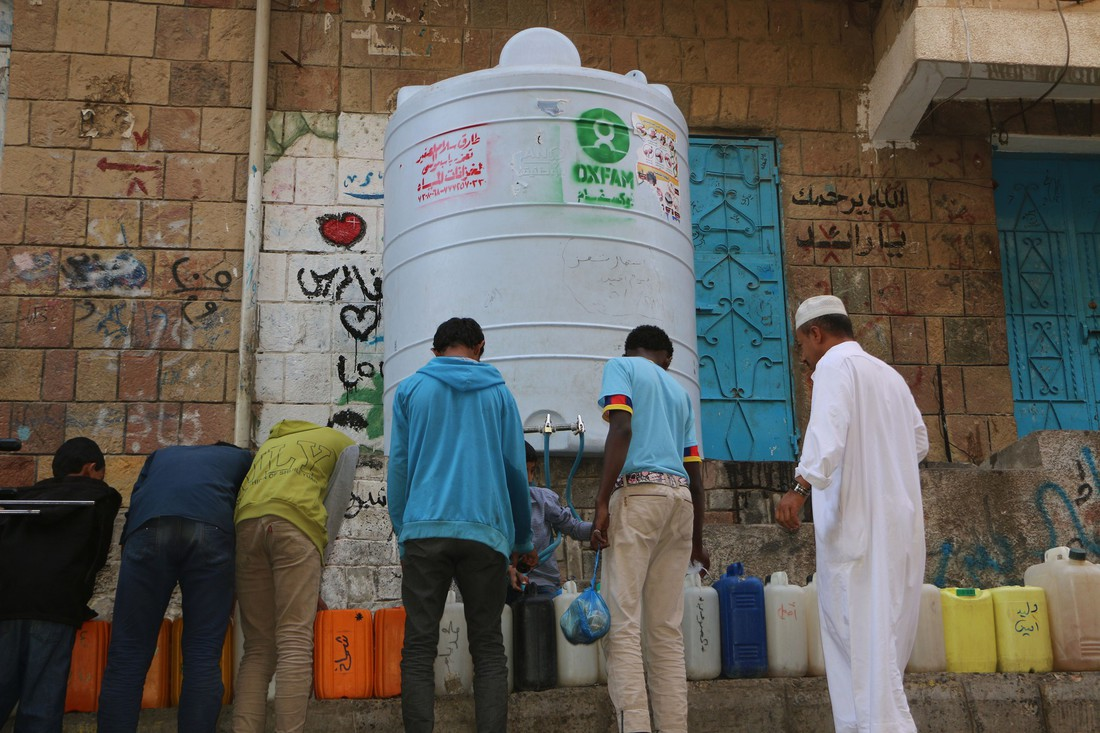Residents of the city collect water from an Oxfam water tank