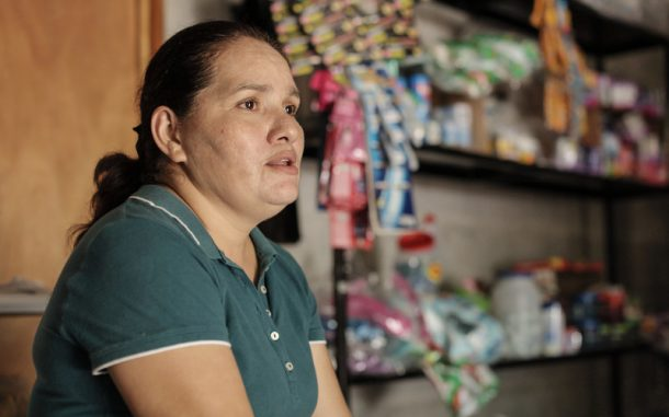 Women fighting for human rights sits in her home