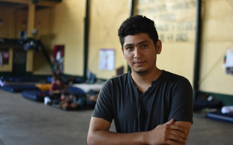 A migrant from El Salvador poses for a picture in a shelter on the Guatemala-Mexico border.