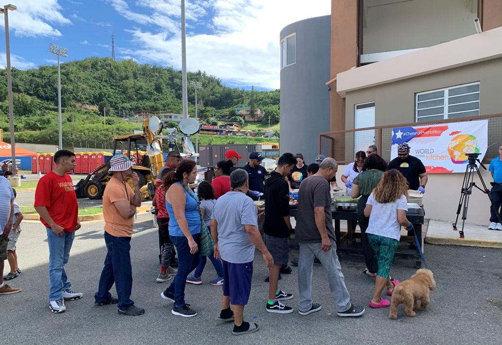 A line of people displaced by recent earthquakes in Puerto Rico.