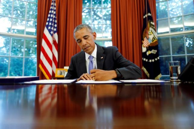 U.S. President Barack Obama signs into law S. 337: FOIA Improvement Act of 2016 and S. 2328: Puerto Rico Oversight, Management and Economic Stability Act at the Oval Office of the White House in Washington