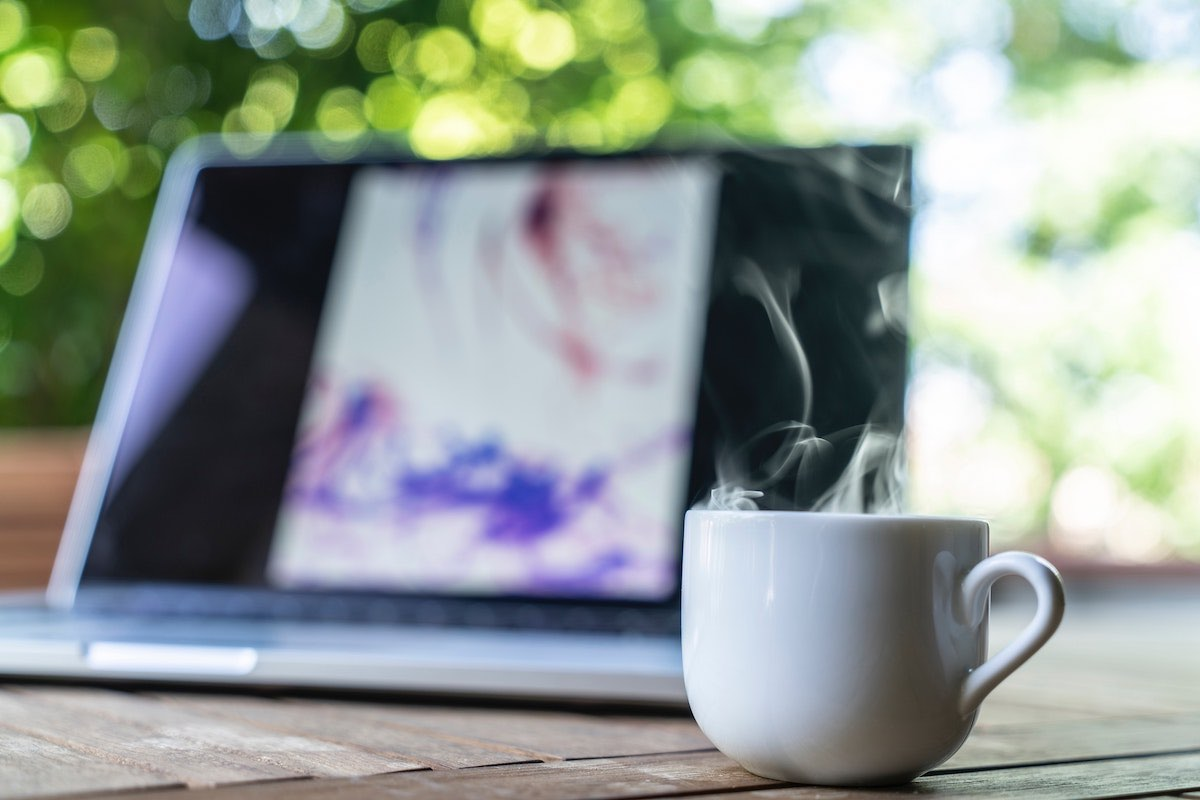 morning coffee while working on laptop in the outdoors