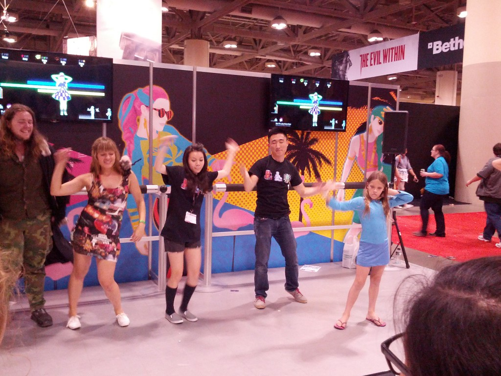 Will and Whinnie taking some time off to check out the JUST DANCE booth
