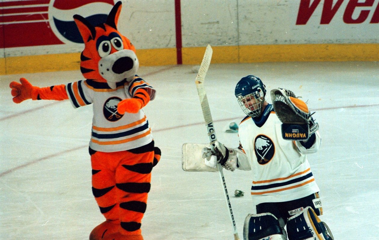 Sabres goalie Dominik Hasek celebrates with Sabretooth after making 70 saves in a 1-0, four-overtime playoff win against the New Jersey Devils on April 27, 1994. (James P. McCoy/Buffalo News)