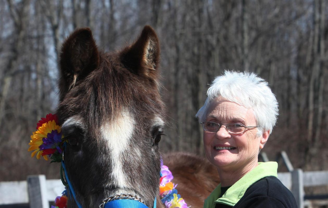 Miriam Smith, former director of Equistar, with Blackie, one of their oldest horses. (File photo)